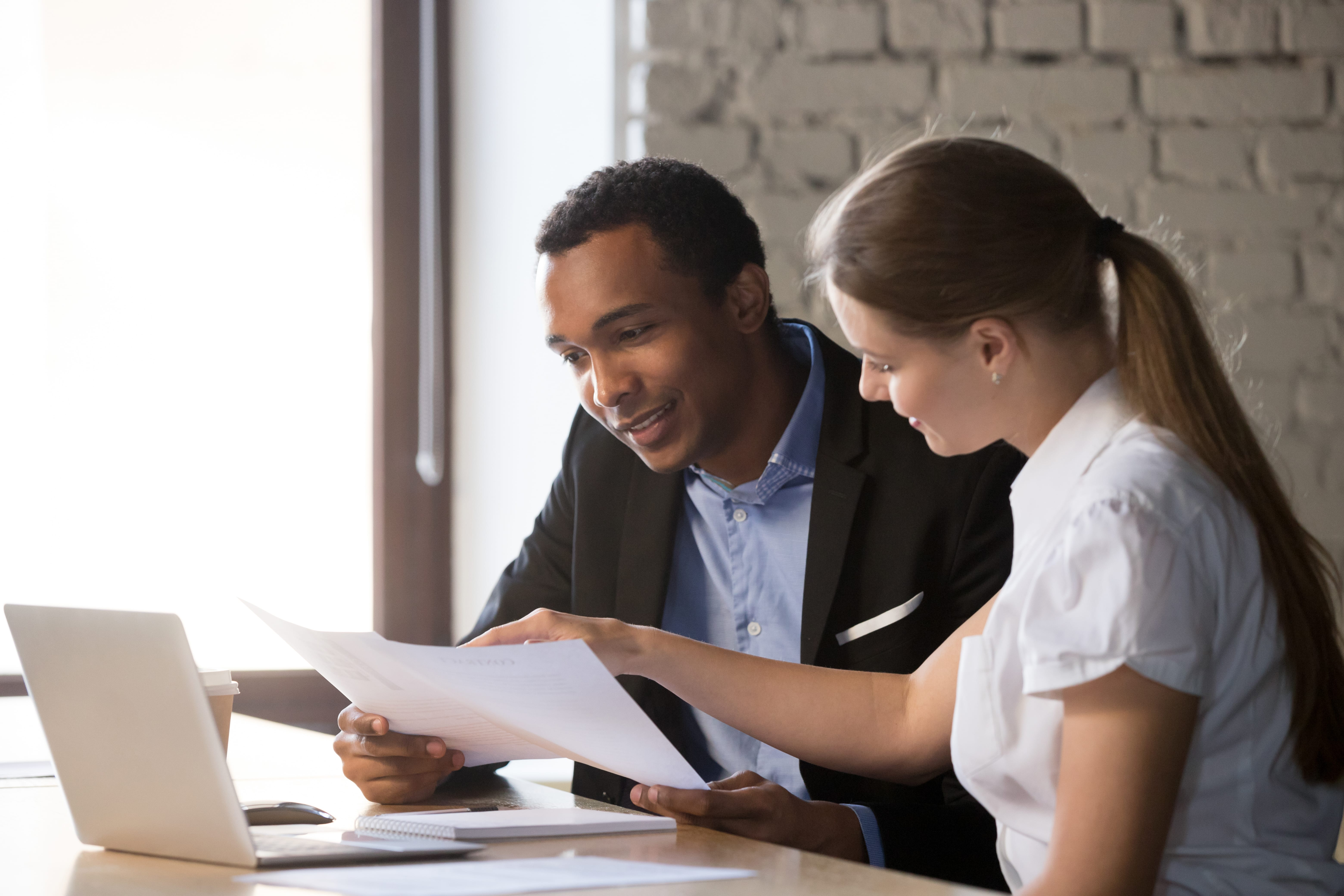 Financial Advisor Consulting Client About Contract