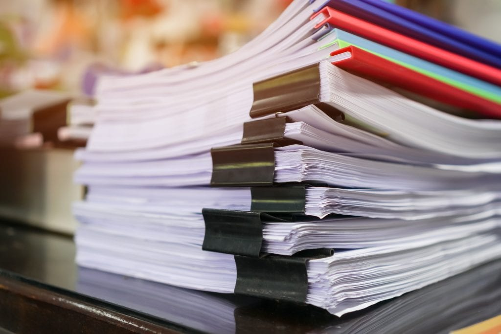 Stacks Of Papers With Color Clips
